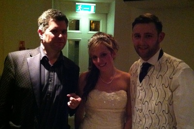 Mike with wedding couple