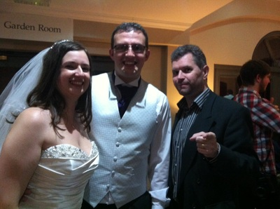 Mike with the bride and groom
